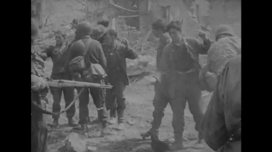 ITALY: 1940s: soldiers captured. Prisoners of war. Injured soldiers. Tanks drive through city