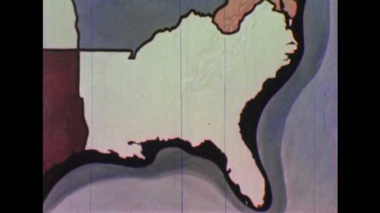 United States: 1950s: animated map of American states. Production in American states. Fields and grass.