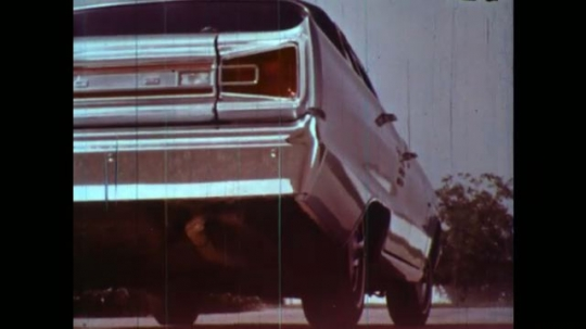 UNITED STATES 1950s: Low angle view, car starting / Exhaust exits tailpipe / Man in lab talks into camera, picks up pitcher.