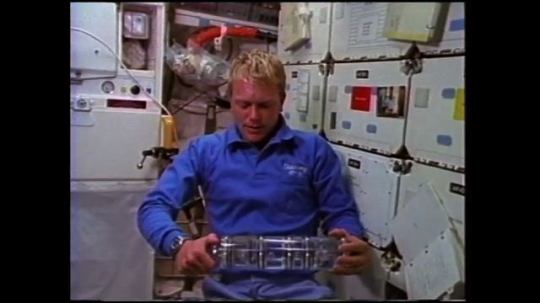 UNITED STATES: 1980s: astronaut grows lead acetate crystals in space. Student experiment in space.