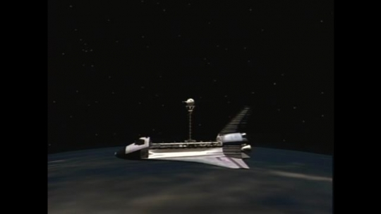 UNITED STATES: 1990s: animation of satellite tethered to space shuttle above Earth. Deployment of tethered satellite