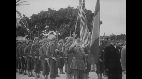 UNITED STATES: 1940s: Soldiers salute. Victory over Rommel. Military planes in sky. Clouds