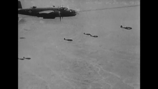 UNITED STATES: 1940s: planes drop bombs from sky.