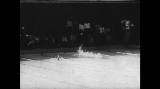 UNITED STATES: 1950s: swimmers in pool. Athletes run race. Baseball player runs. Tennis players on court.