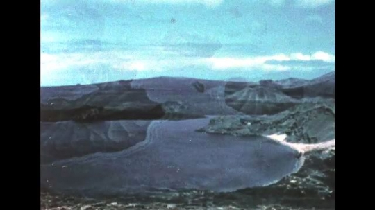 GALAPAGOS: 1950s: View across the Galapagos. Blue footed Boobies. Seals in sea. Penguins on rocks