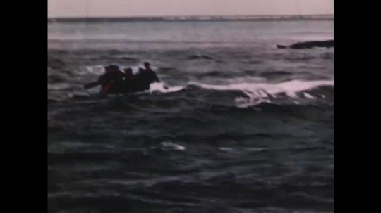 PACIFIC OCEAN: 1940s: men row dinghy over breakers. Researchers collect samples on sandy beach.