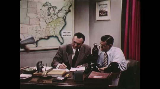 UNITED STATES: 1950s: purchasing department men in meeting.