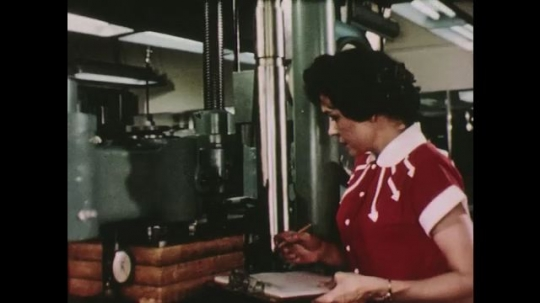 UNITED STATES: 1950s: lady works in research department. Workers in research department. Product development. Industrial research.