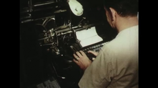 UNITED STATES: 1950s: man types words into printing machine.