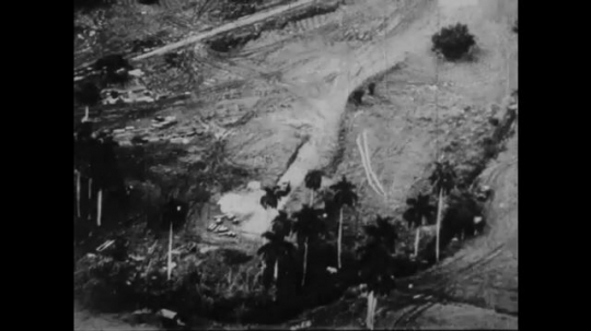 UNITED STATES: 1960S: trees on hill slope. Air force rocket