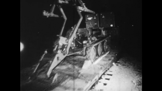 UNITED STATES: 1960S: rail road transportation of military at night. Tactical air command on coast of America