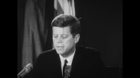 UNITED STATES: 1960S: President Kennedy speaks to audience about Cuba. White House building