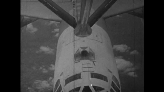 UNITED STATES: 1960S: bomber planes refuel in air. Plane above clouds. Plane takes off.
