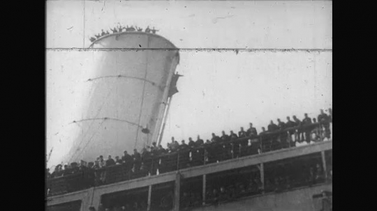 UNITED STATES: 1910s: soldiers depart on ship. Soldiers on deck. People wave to soldiers on ship.