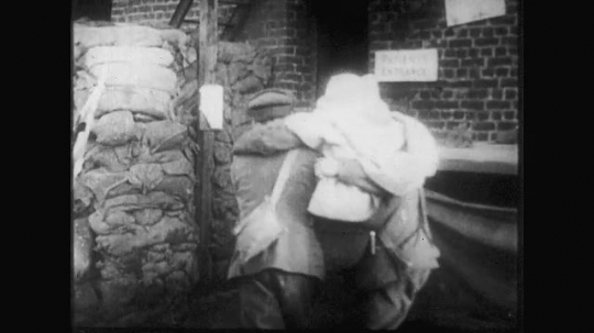 UNITED STATES: 1910s: men carry wounded soldier to hospital. Soldier in operation. Soldiers march through trench. Nurse in operation. Soldier on hospital ward. Medical rounds in field hospital.