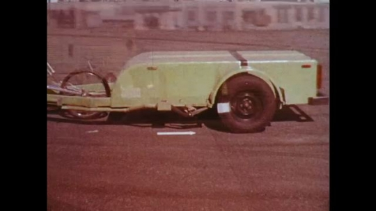 UNITED STATES: 1970s: skid trailer on test surface. Close up of tyres. Highway Safety Research Centre in Texas