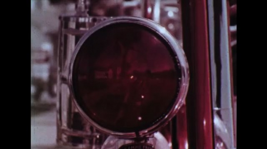 UNITED STATES: 1960s: moving light on vintage fire engine. Bubbles in water, Kaleidoscope view.