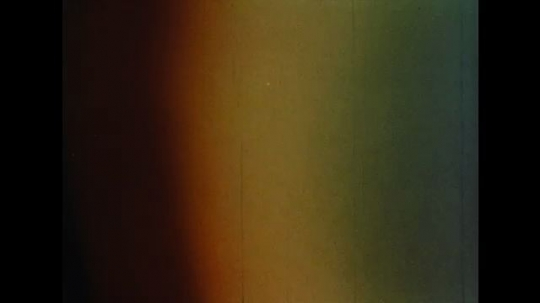 UNITED STATES: 1960s: close up of rainbow colours in light. Pink colour.