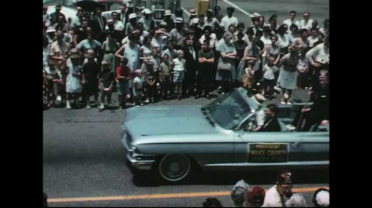 UNITED STATES: 1960s: ladies sit in car for parade