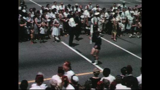 UNITED STATES: 1960s: majorettes in street parade