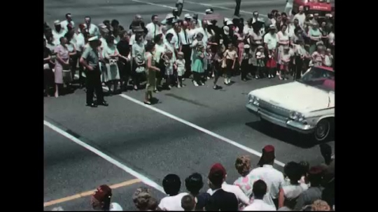 UNITED STATES: 1960s: cars in street parade.