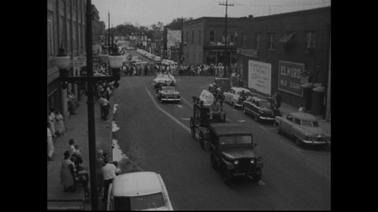 UNITED STATES: 1950s: vehicles in street parade.