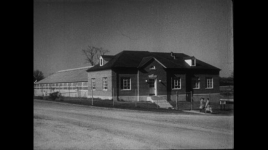 UNITED STATES 1950s: Long shot of the plant industry station in Beltsville, MD.  A long shot of the Knowles Atomic Power Laboratory in Schenectady, NY.