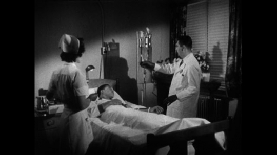 UNITED STATES 1950s: A man lays in a hospital bed at a cancer research hospital. The doctor leaves the room and removes a bottle of radioactive material from a cement casing.