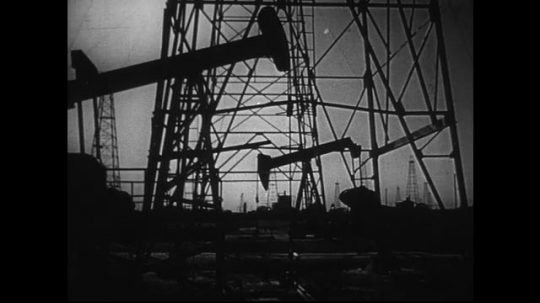 UNITED STATES 1950s : Various shots of oil wells pumping