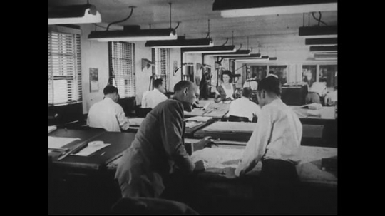 UNITED STATES 1940s-1950s : Engineers discuss at a desk, a man inspects a machine, a car drives up to a laboratory, a man works at a machine, woman types on computer punch card machine