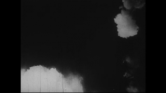 JAPAN 1940s: A white cloud of smoke hovers over the air as flames consume the surrounding.