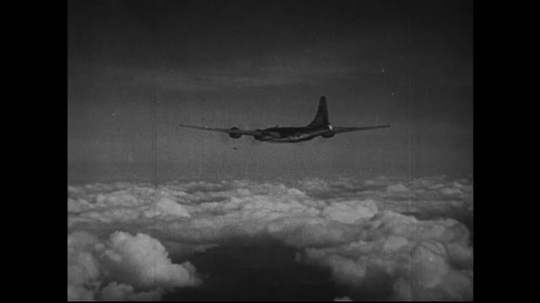 JAPAN 1940s: A B-29 bomber drops an atomic bomb down to Hiroshima, Japan.