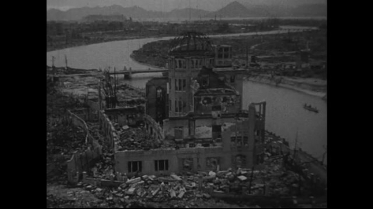 JAPAN 1940s: Nearby commercial museum walls are pushed in by atomic bomb blast.
