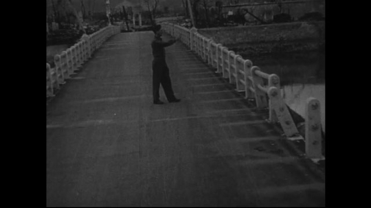 JAPAN 1940s: Near zero point, the ground of a bridge is etched with damages.