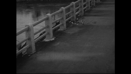 JAPAN 1940s: On the floor of a bridge is an outline of a pedestrian who suffered the wrath of the atomic bomb and fell to the floor.