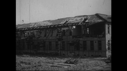 JAPAN 1940s: The north wall of a high school a mile and a half from zero point is badly damaged.