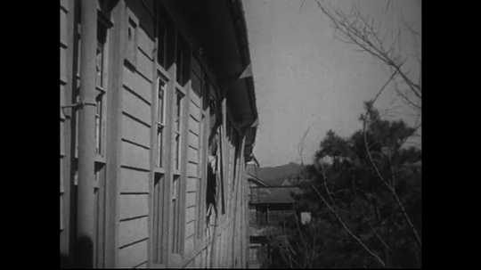 JAPAN 1940s: Side of high school facing zero point leaning in its direction.
