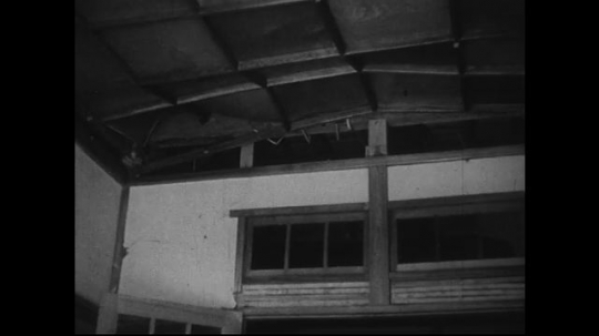 JAPAN 1940s: From four miles away, the ceiling of the Jesuit home is damaged.