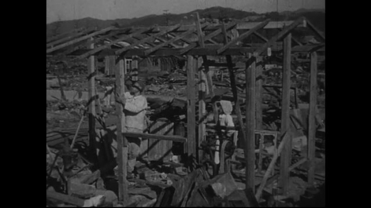 JAPAN 1940s: People are using wood and metal to rebuild their houses.