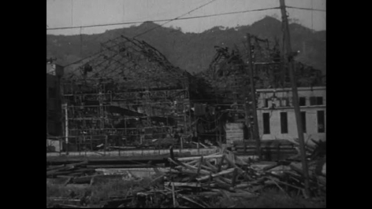 JAPAN 1940s: Buildings of reinforced concrete and smoke stacks remain upright although damaged.