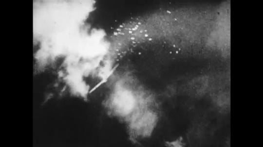 UNITED STATES 1940s: Aerial views of planes exploding.