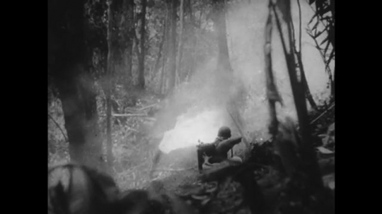 UNITED STATES 1940s: Soldier using flamethrower / Flames in jungle / Soldiers near flames.