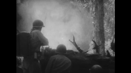 UNITED STATES 1940s: Soldier using flamethrower / Close up, soldier with bazooka / Flames in jungle.