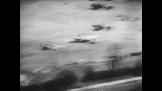 UNITED STATES 1940s: Aerial view of missiles hitting planes on airfield / Plane explodes.