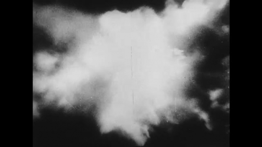 UNITED STATES 1940s: Aerial views of explosions / Plane fires missiles / Aerial views of missiles falling, explosions.