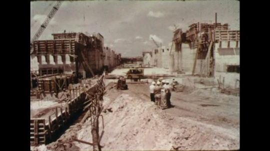 UNITED STATES 1960s: Workers in Cross Florida Barge Canal site / Canal site under construction / View of canal sign, pan to construction.