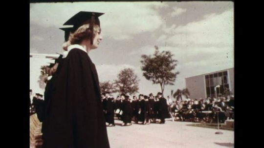 UNITED STATES 1960s: College graduation ceremony / Views of signs for junior colleges / Dissolve to man reporting in TV studio.