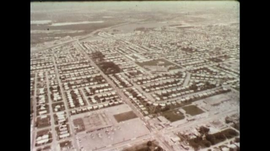 UNITED STATES 1960s: Aerial view of Florida city / View of suburban Florida street.