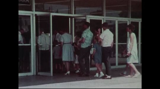 UNITED STATES 1950s : Spectators wait in line with their tickets to enter arena.