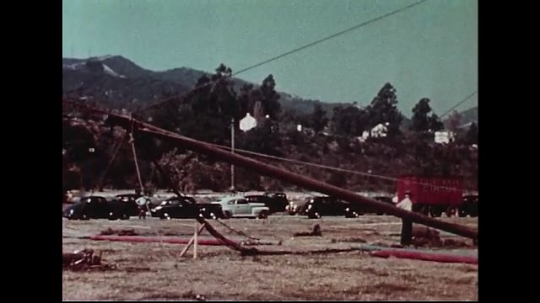 UNITED STATES 1950s : A second center pole of a circus tent is raised up with the aid of ropes.